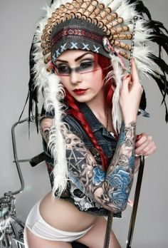 Attractive redhead suicide girl with braids and indian headdress, septum piercing, and full arm ink. Support Tattoos and Piercings At Work. Follow us and go LIKE >>> www.facebook.com/SupportTattoosAndPiercingsAtWork