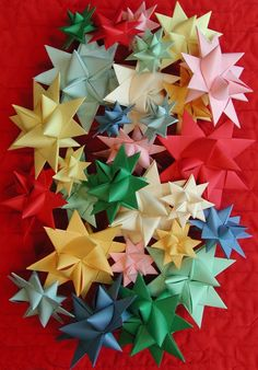 Here are a couple of simple tutorials to help you make paper stars that light up your room! Paper Stars Instructions 5 Point Star Instructions More on TodaysMama: Star Decorations 8 Awesome Eco-Crafts for Kids Printables 3d Paper Star, Paper Stars, Paper Folding Crafts, Paper Crafts For Kids, Christmas Origami, Christmas Crafts, Christmas Ornaments, Christmas Stars, Fall Crafts