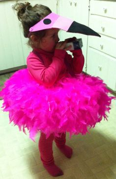 DIY flamingo costume ! Pink suspenders, pool ring, feather boas, pink tights, pink turtleneck, micheals pink foam visor, fuzzy leg warmers and pink dish gloves for feet :)