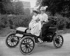 Two Women driving (posing) in a car around 1910. Photographed by Harris & Ewing on 8x10 glass plate negative.