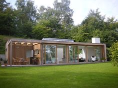 Vacation House Vacation house / Buresø / 2009 A small 100m2 woodden box is located at the bottom of a relativ...