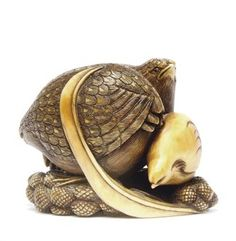 An Ivory Netsuke   With signature Okatomo, Edo Period (19th century)   Of two quail and their chick on millet