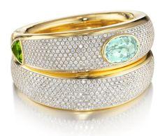"Faraone, Couture. 18Kt yellow gold ""Costa Smeralda"", aquamarine, peridot and diamonds cuff. Below: 18Kt yellow gold and diamonds cuff."