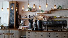 A barista behind the counter of a vintage coffee shop Coffee Shop Counter, Vintage Coffee Shops, Deco Cafe, Opening A Coffee Shop, Café Restaurant, Restaurant Supply, Restaurant Lighting, Restaurant Equipment, Coffee Shop Interior Design