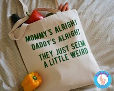 This Cheap Trick-inspired tote is perfect for carrying around your favorite things or stuff for your kiddos. It features green glittery text with lyrics from Cheap Tricks Surrender and reads Mommys alright, Daddys alright, they just seem a little weird.  • Natural color tote bag • Made of 12-ounce heavy canvas • 15 inches by 16 inches with 21-inch handles  All of our products are made to order. If you'd like a different color combination (see image showing our options), include that info in…