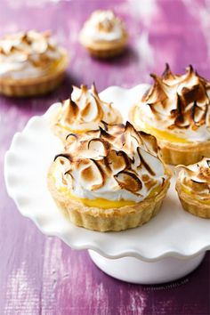 Passion Fruit Meringue Tart with passionfruit curd filling and fluffy marshmallow meringue topping.
