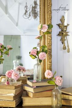 FRENCH COUNTRY COTTAGE: Spring Mantel with camellias, worn books and old bottles ♥ #swingintospring