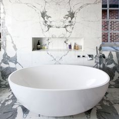 Marble is so popular now and works equally well on walls, as it does floors.