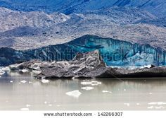 Tasman Glacier ends at Lake with floating icebergs in Aoraki Mount Cook National Park on South Island of in New Zealand