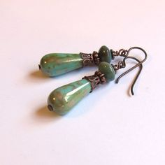 """Green teardrop and jasper vintage inspired earrings .... Antique style copper findings accent my Victorian dangles. Lovely color, romantic and very feminine!  Niobium ear wires in copper color - Niobium is an element not an alloy, making it perfect for those with metal sensitivities. Total length: 1.75 Width: (diameter) 9mm Beads: Jasper, copper and czech glass e2734  For more artisan jewelry by Ox Art Jewelry click """"Shop"""" or go to http://www.etsy.com/shop/OxArtJewelry"""