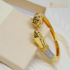 Featuring one of the central themes of the SIMHA collection, with lion heads, this open-type kada is a symbol of strength and grandeur. Add elegance to your classic attire. Gold Rings Jewelry, Gold Jewellery, Gold Earrings, Jewelry Necklaces, Brooch Men, Jewellery Shop Design, Mens Gold Bracelets, Gold Chain With Pendant, Open Type