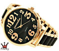 Γυναικείο ρολόι, με κάσα σε ροζ χρυσό και μαύρο εσωτερικό καντράν.Μεγάλα νούμερα σε ροζ χρυσό στο εσωτερικό του.  Μαύρο/ροζ χρυσό μπρασελέ.  Διάμετρος καντράν 48 mm