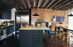 West Village townhouse by Made.  Love that the cabinets don't take away from the beauty of the beams and bricks.