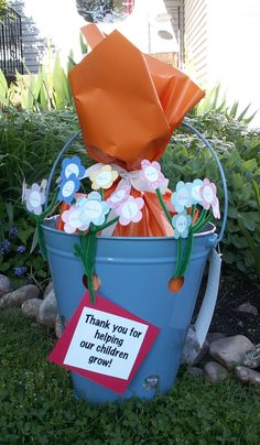 """I made this for Teacher Appreciation Day. It's a Veggie/Strawberry planter, wrapped in orange paper are gardening tools, soil, strawberry seeds & gardening gloves. I also made each flower and put all the children's names from the class, along with the sign """"Thank you for helping our children grow"""" Happy creating!"""