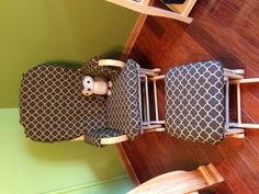 Old glider chair re-upholstered with a more modern pattern for baby's room.