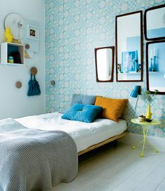 headboard alternative: beautiful wallpaper and mismatched mirrors, tightly hung