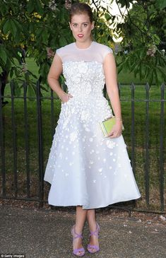 Striking: Princess Beatrice looked stunning in a soft pink and and white embellished gown ...