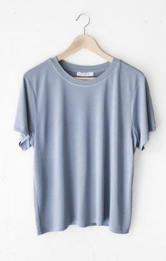 """- Description Details: Soft & relaxed basic tee in dusty blue. Relaxed fit. Measurements (Size Guide): S: 44"""" waist, 23.5"""" length M: 46"""" waist, 24.0"""" length L: 48"""" waist, 24.5"""" length 64% Modal, 36% P"""