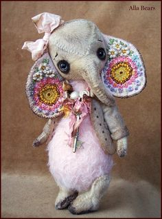 Welcome to my Old toy shop,    Flower Garden  elephant I would like for you to meet my new creation, Sweet  Flower Garden  Ellie. Hand made by me with