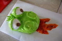Dragon cake...cupcake eyeballs, tootsie roll pupils and fruit rollup fire. Easy peasy!