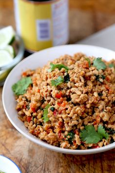 Thai Basil Chicken - This easy Thai basil chicken recipe is based on the classic Thai Krapow Gai Kai Dow dish. It's hot, pungent, salty and smoky. Squeeze a fresh lime on top and your taste buds will be dancing in no time! | pickledplum.com