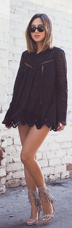Aimee Song is wearing a black lace dress/top with sleeves.