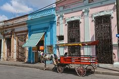 Eight Free Flights to Cuba – Register by April 30th - Horse-drawn carriage on the streets of Santa Clara. Travel to Cuba before scenes like this begin to disappear.