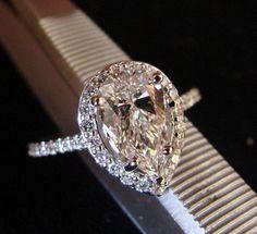 Halo Style Pear Shape Diamond Engagement Ring.