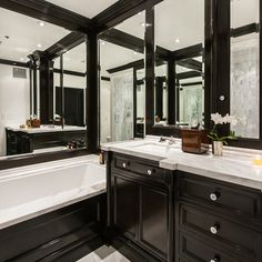 Love this black and white bathroom with mirror sparkle.