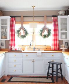 Curtain rod above kitchen window  Talk of the House  Christmas wreaths in windows