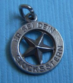 Vintage German lucky star silver charm