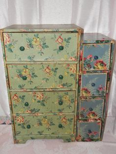 love these vintage wallpaper drawers