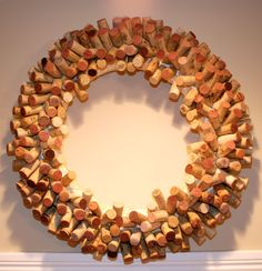 Here is my wine cork wreath.  I started with a straw wreath and used straight pins to stick into the bottom of the corks just a little bit and then poked the head of the pin into the wreath.