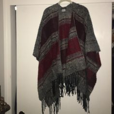 Red,Gray& Black Poncho with Fringe Never worn,without tags. OSFA poncho, in a beautifully knit yarn that feels very much like wool without the itchiness. Bought it with the intent to use this winter but never got around to it. (Will update better photos in morning) Ellen Tracy Sweaters Shrugs & Ponchos