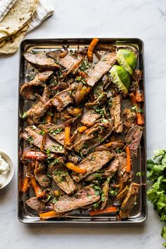 This easy recipe for Sheet Pan Steak Fajitas is perfect for quick weeknight dinners. Simply toss the steak and vegetables in an easy Mexican seasoning and roast everything on one sheet pan. Making fajitas from scratch has never been easier! Steak Fajita Marinade, Steak Fajitas, Homemade Tortilla Chips, Homemade Tortillas, Quick Weeknight Dinners, Easy Meals, Mexican Food Recipes, Beef Recipes, Mexican Seasoning
