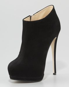 Giuseppe Zanotti - I have shoes identical to these from South Moon Under for $60. :)