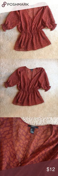 Chiffon top Burnt red chiffon top. Elastic in the waist for a flattering fit. Buttons down the front. Elastic in the arms to keep the fit of the shirt. Worn once. No signs of wear. Forever 21 Tops Blouses