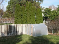 Build one of these to hold a hot box for germination.  Cement blocks/hot box should hold it down in wind.  Compost can just go on the ground then and take the house apart during the summer.  Could build inside the hoop house too for extra protection.  Just need to figure out venting