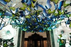 Love the garden gorgeous vibe of oversized butterflies and flowers on the entrance to the Claridge's Ballroom for the @Mulberry_Editor Autumn 2013 show #decor #design #fashion