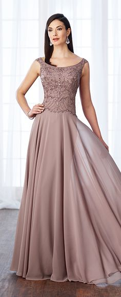 Tip-of-the-shoulder chiffon A-line gown with tapered shoulder straps, front and back scoop necklines, hand-beaded bodice, scalloped natural waist, softly gathered skirt with sweep train. Matching shawl included.