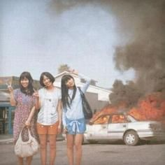 National Lampoons Asian Explosion In This Picture: Photo of girls in front of exploding car