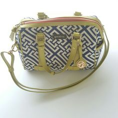 Spartina bag From their website -  out of stock on website! Exterior pockets on either side.  Removable shoulder strap.  Linen and leather.  Hanging logo medallion.  2 interior open pockets.  Interior zipper pocket.  Height 6.5, depth 4, width 10.5.  My bag is in excellent used condition. Photos are of my bag taken by me.  Spartina 449  Bags Satchels