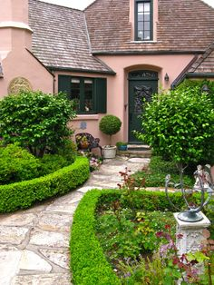 I love low hedges.  you can put anything behind them and they look beautiful