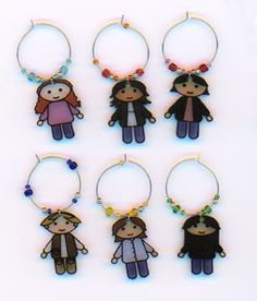 shrinky dink cartoons of your guests.  My kids love to drink juice from whine glasses and would love this.