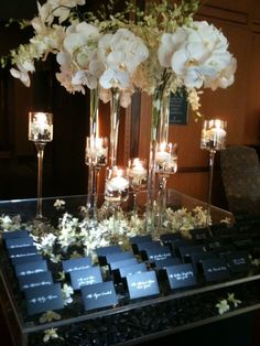 Orchids, candles, staggered heights, mixed width, black and white contrast, sparkle, place card table