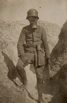 "historywars: "" WW1: German storm trooper poses in the trenches with gas mask and potato masher hand grenades. His job was to rush enemy trenches, usually at night, and establish possession for the infantry wave to take over. """