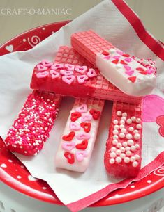 Valentine cookies - strawberry sugar wafers dipped in white chocolate or colored candy melts and topped with holiday sprinkles.