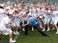 North Carolina coach Joe Breschi does the dab with his team after the Tar Heels' 14-13 victory over the Maryland Terrapins in the NCAA Division I Men's Lacrosse Championship at Lincoln Financial Field on May 30, 2016 in Philadelphia.
