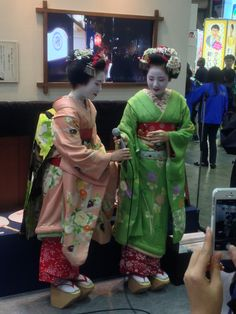 "They are Japanese ""Maiko"" who are the professional young dancers of traditional Japanese dance. Not Geisha. They are sooo cute and beautiful, aren't they?"