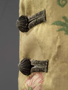 Boy's coat (image 4 - detail) | Italian | 1715-50 | Silk-brocaded lampas with silver file | Royal Ontario Museum | Object #: 984.81.2